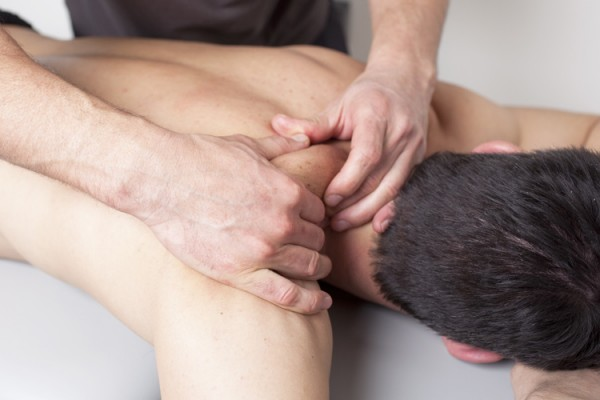 physical therapist applying myofascial therapy